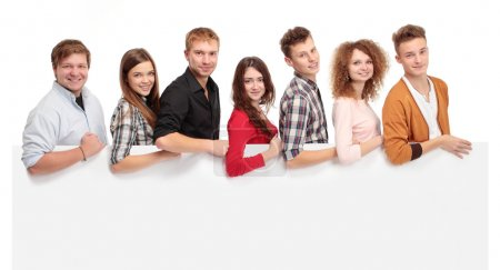 Photo for Group of smiling friends holding blank banner - Royalty Free Image
