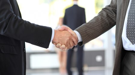 Business men closing deal with a handshake