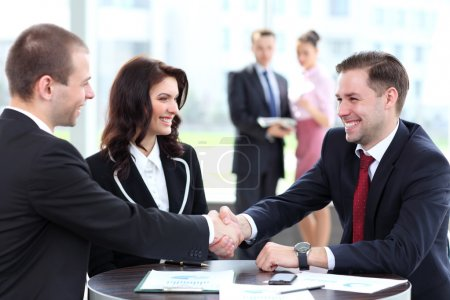 Photo for Business shaking hands, finishing up a meeting - Royalty Free Image