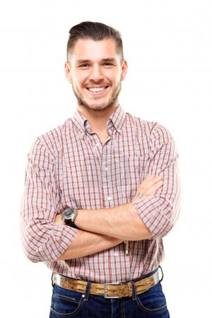 Photo for Casual young man looking at camera with arms crossed and satisfaction - Royalty Free Image