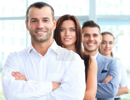 Photo for Happy smiling business team standing in a row at office - Royalty Free Image