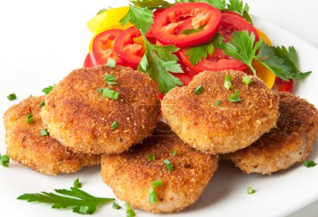 Chicken cutlets with vegetables and herbs...