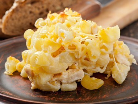 Macaroni with cheese, chicken and mushrooms baked in the oven
