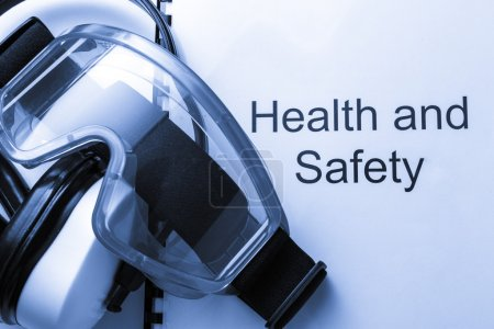 Photo for Health and safety register with goggles and earphones - Royalty Free Image