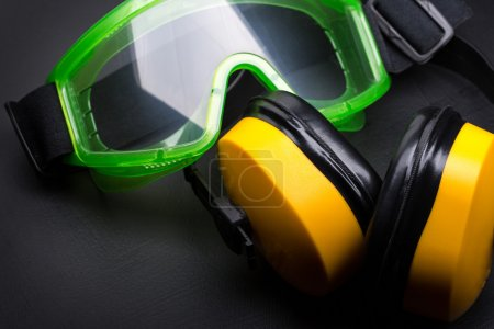 Photo for Green goggles with earphones on black - Royalty Free Image