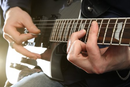 Photo for Electric guitar in male hands - Royalty Free Image