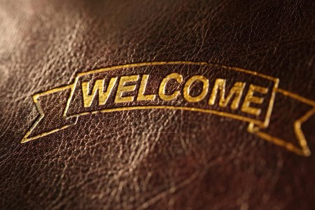 Photo for Welcome inscription on leather background - Royalty Free Image