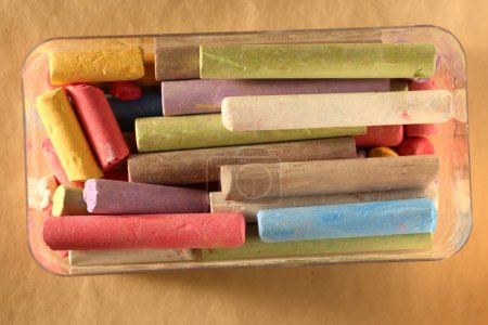 Photo for Pastel chalks in box on paper - Royalty Free Image