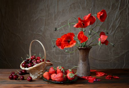 Photo for Poppy in a ceramic vase, cherries and strawberries on table - Royalty Free Image