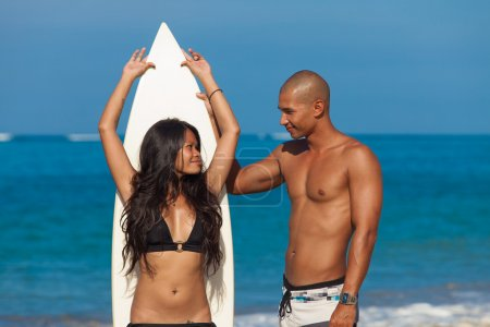 couple with surfboard
