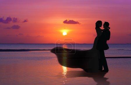 Married Couple on sunset beach