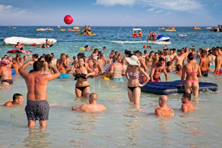 Photo for COSTINESTI, ROMANIA - AUGUST 6: Crowded beach with tourists in summer on August 6, 2012 in Costinesti, Romania. Costinesti is a famous summer destination for hundred of thousands of tourists a year. - Royalty Free Image