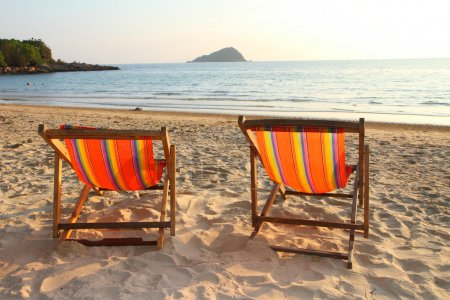 Twin deck chairs on the beach