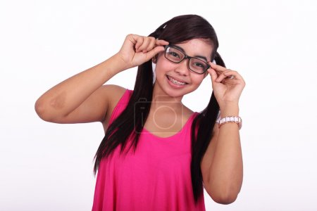 Asian model with new glasses isolated in white