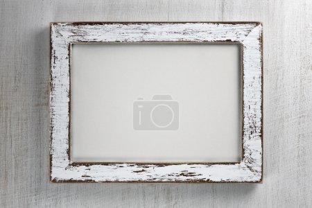 Vintage wooden frame on wall background
