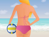 Blonde girl wearing a pink bikini standing in front of a beach holding a volley ball