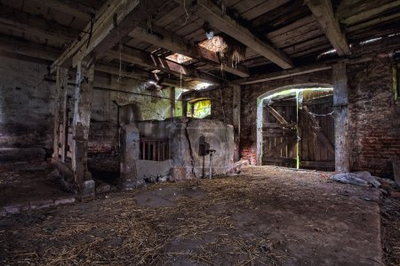 Interior of an old, decaying barn.