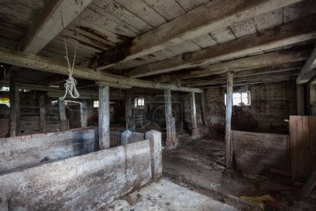 Photo for Old, built of wood and brick, abandoned barn - Royalty Free Image