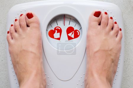 Photo for Female feet on bathroom scale with concept symbols for health care - Royalty Free Image