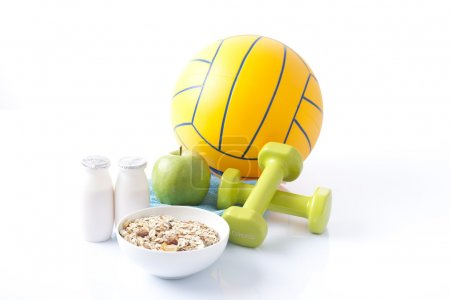 Healthy food and sport equipment isolated on white...
