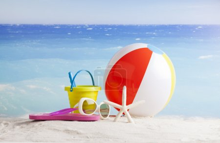 Beach accessories with beach ball, sun glasses and starfish