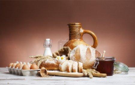 Vintage jug, bread and  seeds,isolated