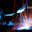 Sparks while welder uses torch to welding...