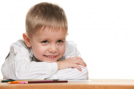 Smiling little boy at the desk