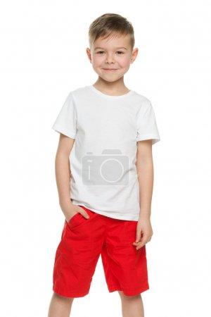 Photo for A smiling little boy in white shirt isolated on the white background - Royalty Free Image