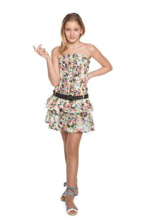Fashion pretty preteen girl against the white