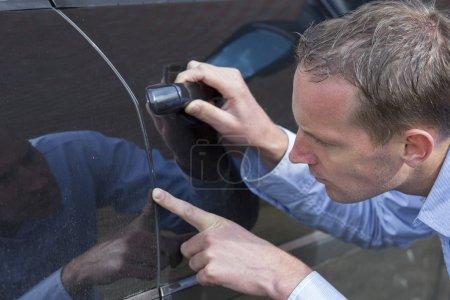 Man Checking His Car.