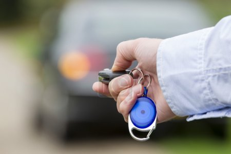 Man Holding Car Remote Key.