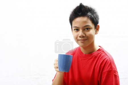 Teenager Holding a Mug