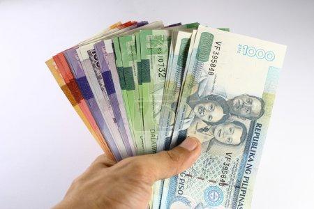 Philippine Peso Bills Held in Hand