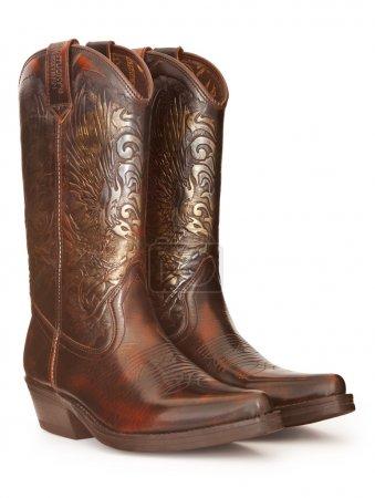 Photo pour Paire de bottes de cowboy isolé sur blanc avec un tracé de détourage - image libre de droit