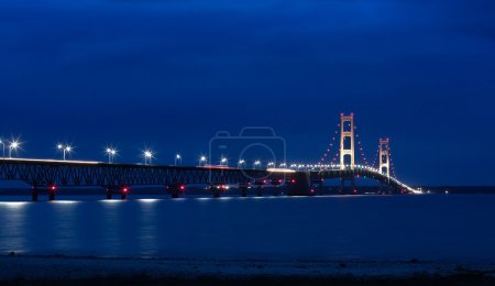 Photo for The Mackinac Bridge is located on Interstate 75 in northern Michigan at the Straits of Mackinac. The bridge connects Michigan's upper and lower peninsulas. - Royalty Free Image