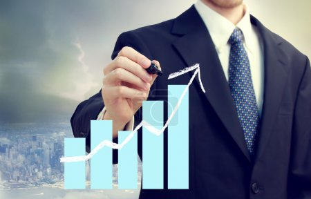 Business Man with Chart Showing Growth