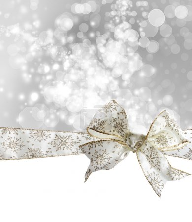 Photo for White Snowflake Bow and Ribbon with Bokeh Lights Background - Royalty Free Image