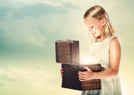Photo for Happy Blonde Girl Opening a Treasure Box - Royalty Free Image