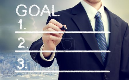 Businessman Listing Goals