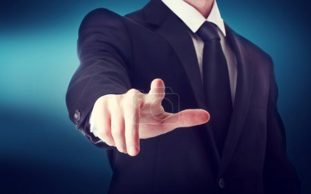 Business man with pointing to something or touching a touch screen