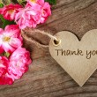 Heart shaped thank you card with flowers on wood b...