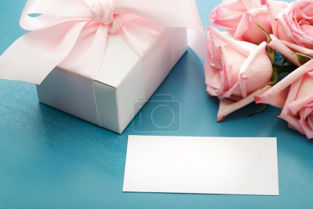 Blank message card with gift box and roses
