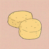 Two corn bread muffins on red halftone background