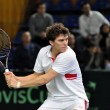 Постер, плакат: Thomas Kromann in action at a Davis Cup match Romania wins against Denmark Denmark with 2:0