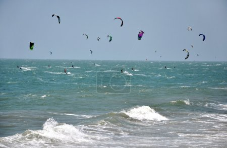 Kite surfers kite surfing in Mui Ne, Vietnam