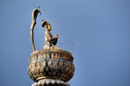 King Yoganarendra Malla bronze statue on a column in Patan, Nepal