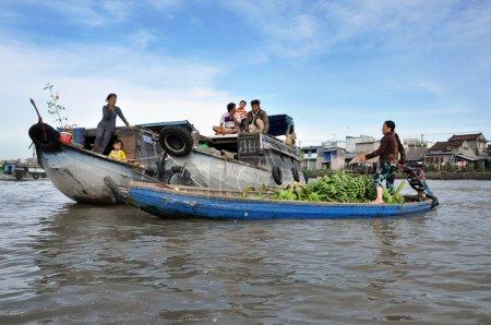 Fruit sellers in the Floating market. Mekong delta, Vietnam