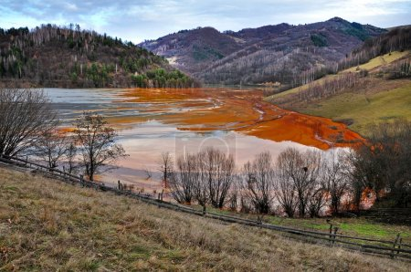 Contaminated lake full with mining waste residuals in Rosia Mont