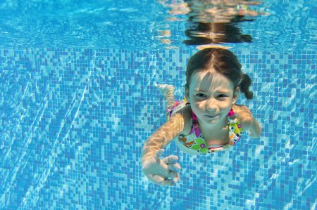 Photo for Happy smiling underwater child in swimming pool, beautiful girl swims and having fun. Kids sport on family summer vacation. Active healthy holiday - Royalty Free Image